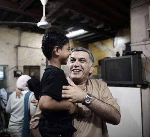 Bahraini human rights activist Nabil Rajab carries the son of Abdul Aziz al-Abbar, a Bahraini man who died from his wounds on February 23 after he was shot during clashes between police and protesters, on May 24, 2014 in the village of Sanabis, west of Manama. Rajab was recently released after 2 years in prison. AFP PHOTO/MOHAMMED AL-SHAIKH (Photo credit should read MOHAMMED AL-SHAIKH/AFP/Getty Images)