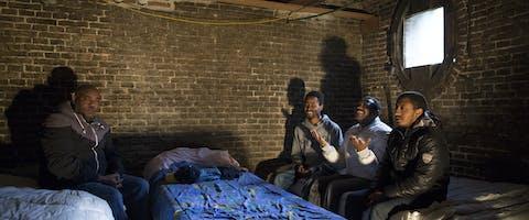 Uitgeprocedeerde asielzoekers van de groep 'We are here' verblijven in oktober 2015 in de kelder van het Wereldhuis in Amsterdam.