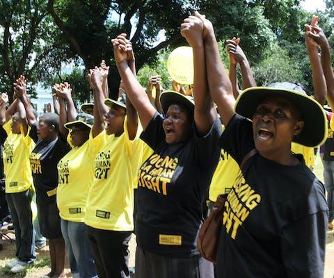Zimbabwanen bij een evenement van Amnesty in Harare