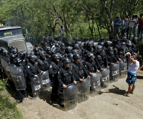 Women from the La Puya resistance pray and read the bible as they attempt to pursuade the police to retreat. After two years and two months of peacefully blocking the entrance to the El Tambor gold mine (Kappes, Cassiday & Associates (KCA) which is based in the USA). Residents of San Jose del Golfo and San Pedro Ayampuc were violently evicted by police forces in order to bring heavy machinery into the industrial site.