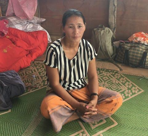 De 37-jarige Maji Hka Tawm vluchtte na beschietingen uit het Zai Awng vluchtelingekamp in Kachin staat, Myanmar. December 2016