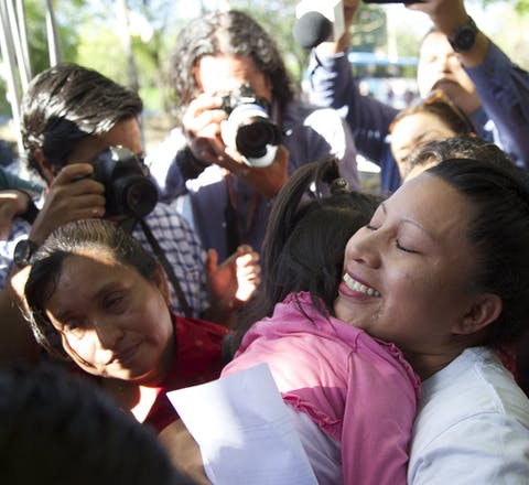 Teodora Vasquez hugs her family and friends shortly after being released from the women's Readaptation Center, in Ilopango, El Salvador on February 15, 2018, where she was serving a sentence since 2008, handed down under draconian anti-abortion laws after suffering a miscarriage.