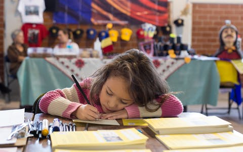 A girl writing a letter at a local University in Mexico