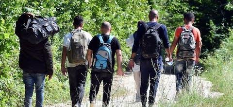 Migranten bij de grens tussen Kroatië en Bosnië